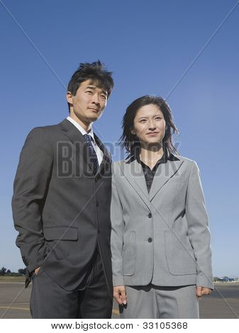 Low angle view of Asian businesspeople