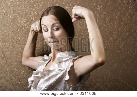 Young Woman Admiring Her Bicep