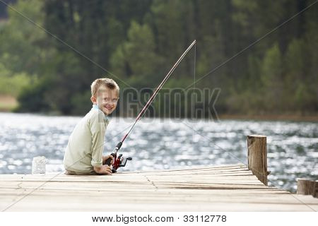 Young boy fishing on a jetty