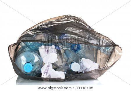 open black garbage bag with trash isolated on white