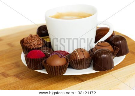 cup of coffee with chocolate pralines