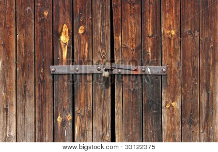 Old Wooden Door Locked With Rusty Padlock