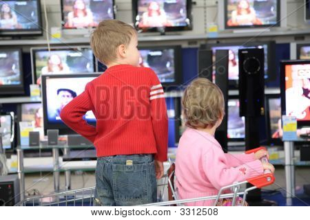 Children In Carriage For Purchases Look At Tvs In Shop