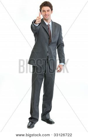 Full Length Portrait Of Businessman Showing Thumbs Up