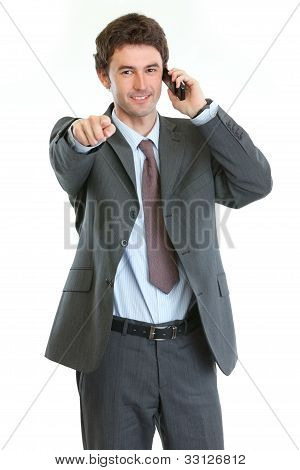 Modern Businessman Speaking Cell Phone And Pointing On You