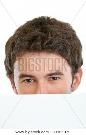 Man Hiding Behind Blank Billboard