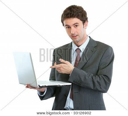 Surprised Businessman Pointing In Laptop