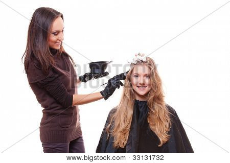 young stylist and blonde woman. studio picture over white background
