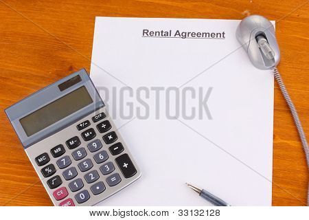 Rental agreement on wooden background close-up