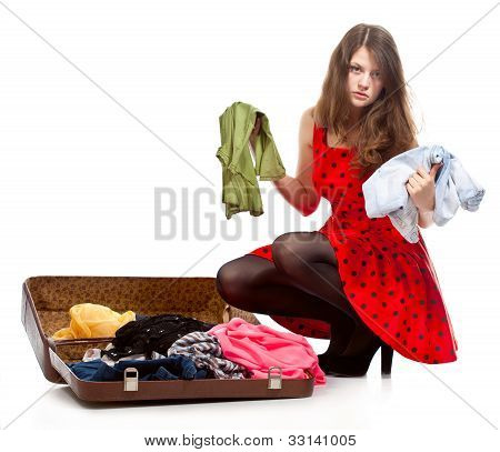 Young teenage girl with an opened suitcase