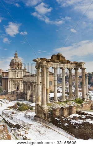 Temple Of Saturn And Others Monument Of The Roman Forum, Italy.
