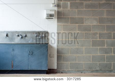Grunge Interior With Wall And Washing Trough
