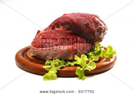 Red Raw Beef Meat And Salad Over White