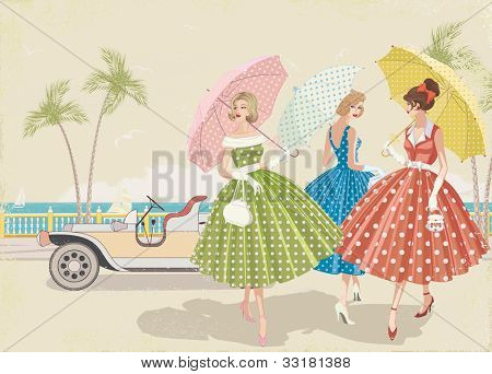 Three elegant women with parasols dressed in polka dots dresses walking near beach