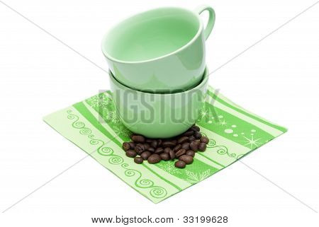 Two Empty Cups And Coffee Beans.