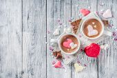 Valentines Day Treat Ideas, Two Cups Hot Chocolate Drink With Marshmallow Hearts Red Pink White Colo poster
