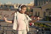 I Love My Pigtail Hairstyle. Small Child Wearing Braided Hairstyle And Headphones Outdoor. Little Gi poster