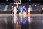 blurred background of basketball players on court during game - very shallow depht of field poster