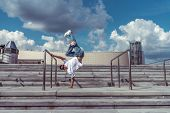 Strong Male Dancer, Standing On One Arm In Jump, Dancing Breakdance, Summer City, Background Cloud S poster