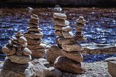 Stack Of Pebbles. Balancing On A River Background.rocks Stacked Close Up In A River Bed. poster