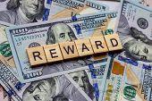 The Word Reward On Dollar Usa Background. Rewarding And Financial Bonus Concept. poster