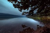 Crack Of Dawn On Lake Bohinj In Slovenia, Beautiful Tranquil Landscape With Autumnal Fog On The Lake poster