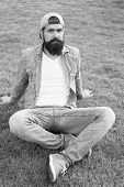 Cool Hipster With Beard Wear Stylish Baseball Cap. Brutal Handsome Hipster Man Resting On Summer Day poster