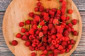 Raspberries On A Wooden Plate. Wooden Round, Flat Plate. On A Wooden Background. Wooden Blocks With  poster