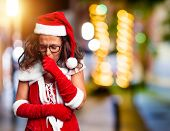 Middle age woman wearing Santa Claus costume feeling unwell and coughing as symptom for cold or bron poster