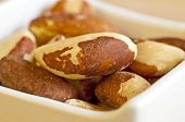 stock photo of brazil nut  - closeup of fresh crispy para nuts in a bowl - JPG