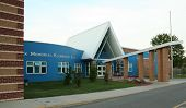 foto of school building  - very colorfull blue with red brick elementary school building - JPG