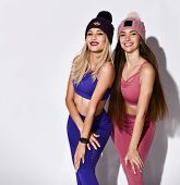 Attractive Women, Body Image Of A Fit Woman Wearing A Sports Bra And Leggings, In Knitted Hats, With poster