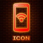 Glowing Neon Smartphone With Free Wi-fi Wireless Connection Icon Isolated On Brick Wall Background.  poster