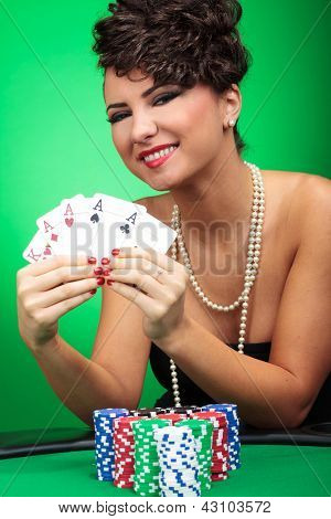 beautiful young woman showing her cards
