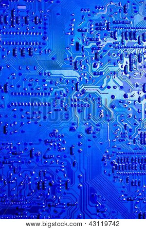 Blue lit computer circuit board closeup