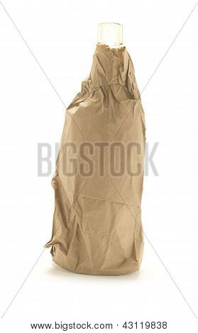 Bottle of whiskey  in a brown paper bag