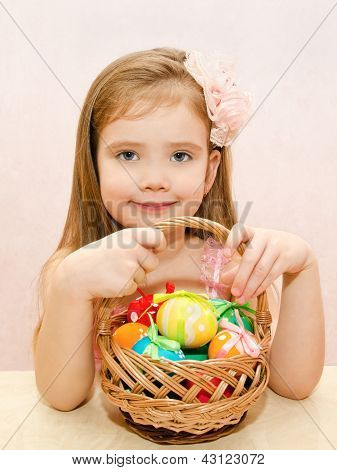 Little Girl With Basket Full Of Colorful Easter Eggs
