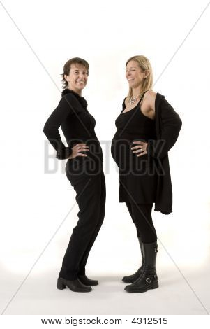 Couple Of Young Women Comparing Their Belly