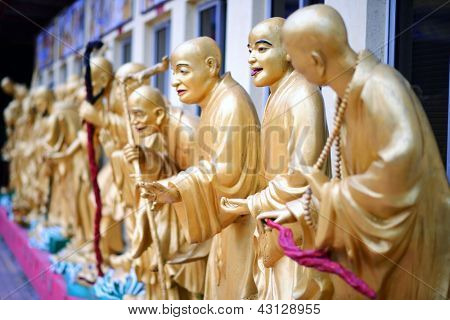 Statues sat Ten Thousand Buddhas Monastery in Sha Tin, Hong Kong, China.