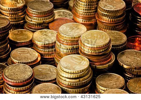 piles of golden euro cent coin