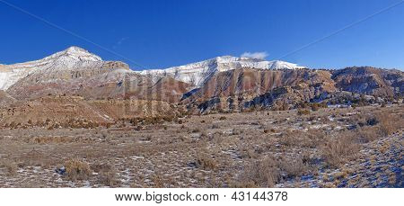 Light Winter Snow On Eroded Mountains
