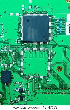 Close Up On A Part Of The Old Electronic Circuit Boards  Background