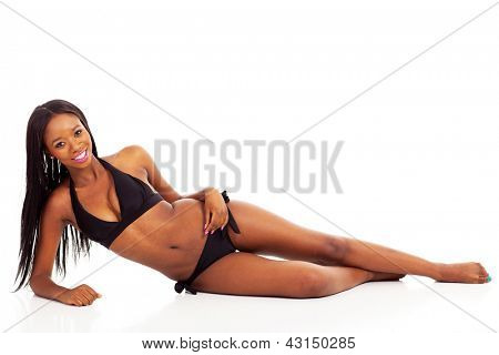 attractive african woman in bikini lying on white background