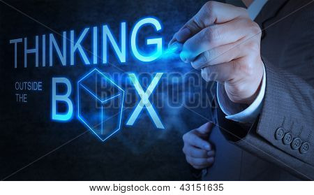 Businessman Hand Draw Thinking Outside The Box