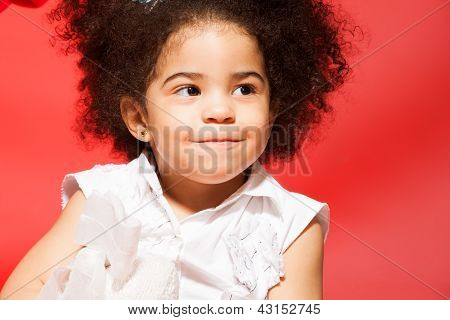 Portrait Of Little Cunning Curly Haired Girl