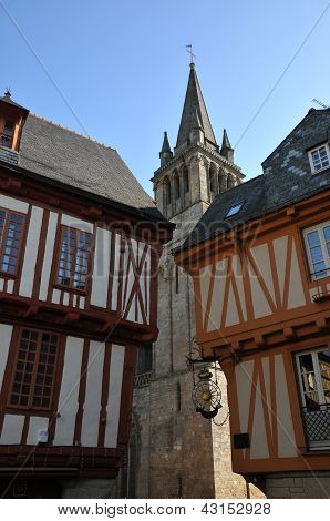 Two Old Half-timbered Houses With A Church Inside Vannes Streets