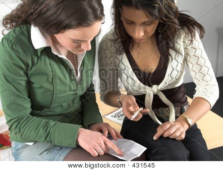 Two Teenage Girls Checking Pregnancy Test