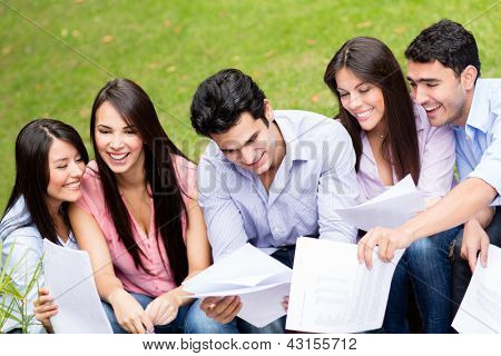 Group of students studying outdoors looking very happy