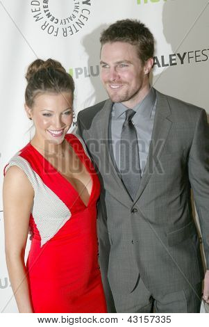 BEVERLY HILLS - MARCH 9: Katie Cassidy and Stephen Amell arrives at the 2013 Paleyfest