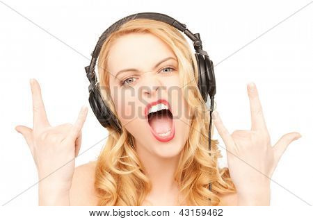 singing woman with headphones showing rock n roll sign